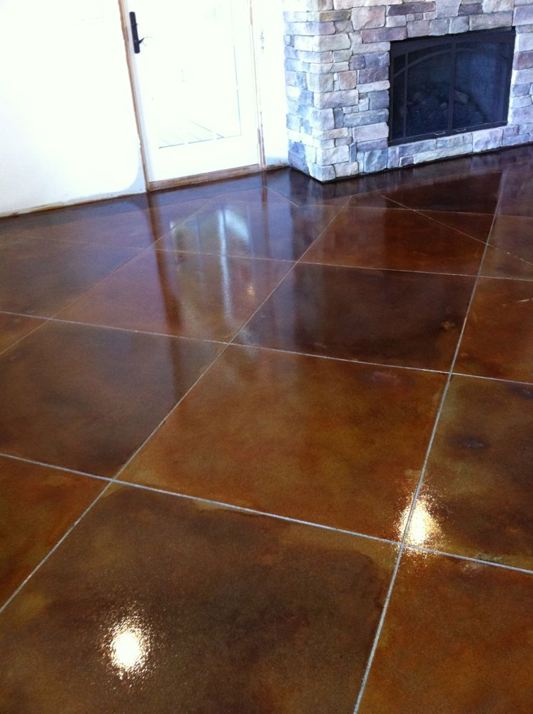 Scoring lines in a multi colored stained concrete floor for How to care for stained concrete floors